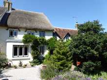 Picturesque grade II listed part thatched cottage with delightful extensive gardens..